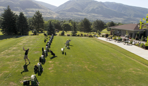 Al Hartmann  |  The Salt Lake Tribune Golfers hit some balls on the driving range at Oakridge Country Club in Farmington. The Utah Department of Transportation cited club opposition as one of the factors in its choosing a different route for the West Davis Corridor freeway.