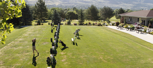 Al Hartmann  |  The Salt Lake Tribune Golfers hit some balls on the driving range at Oakridge Country Club in Farmington Thursday June 20.
