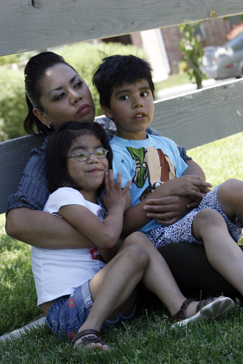 Francisco Kjolseth  |  The Salt Lake Tribune Maxima Uribe spends time at a park in Eagle Mountain with her kids Karina, 7, and Diego, 6, Aguilar recently. Her family that was torn apart when her husband was deported back to Mexico in November of 2010 faces struggles with her daughter who has serious heart condition and medical expenses.