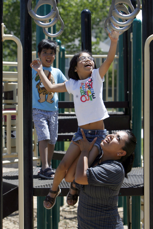 Francisco Kjolseth  |  The Salt Lake Tribune Maxima Uribe spends time at a park in Eagle Mountain with her kids Karina, 7, and Diego, 6, Aguilar recently. The family faces a decade or more without husband and father Jose Uribe, who was deported to Mexico.