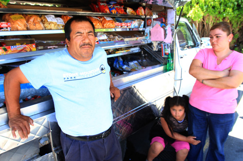 Rick Egan  | The Salt Lake Tribune  Domingo Gonzalez (left) with his 7-year-old daughter Susana and his wife Maritza Gonzalez pose with their food truck. The Kearns family lives in dread over upcoming deportation hearings for Domingo. He was stopped at the border while returning from a visit to his ailing father in Mexico.