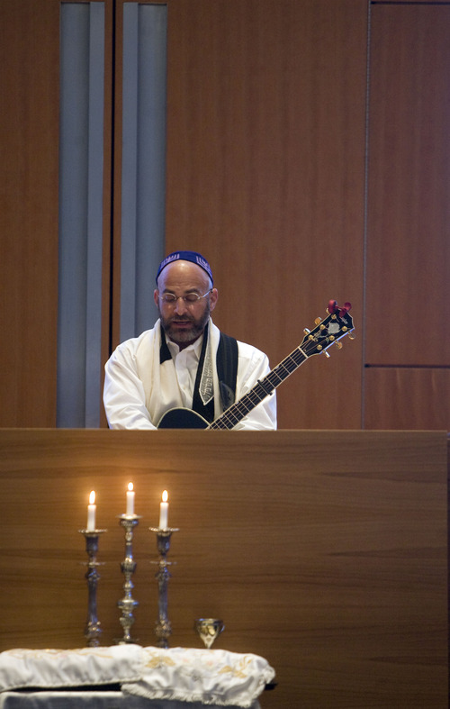 Kim Raff  |  The Salt Lake Tribune Rabbi Joshua Aaronson leads a Shabbat service at Temple Har Shalom in Park City on May 31, 2013. Rabbi Aaronson will be leaving the congregation at the end of the month.
