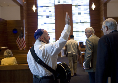 Kim Raff  |  The Salt Lake Tribune Rabbi Joshua Aaronson greets people arriving for a Shabbat service at Temple Har Shalom in Park City on May 31, 2013. Rabbi Aaronson will be leaving the congregation at the end of the month.