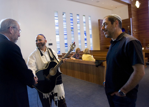 Kim Raff  |  The Salt Lake Tribune (middle) Rabbi Joshua Aaronson greets (left) John Davis and (right) Michael Greenfield as they arrive for a Shabbat service at Temple Har Shalom in Park City on May 31, 2013.Rabbi Aaronson will be leaving the temple at the end of the month.