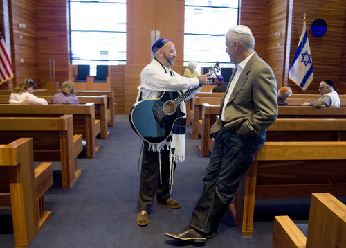 Kim Raff  |  The Salt Lake Tribune Rabbi Joshua Aaronson talks with Lee Gerstein before the start of a Shabbat service at Temple Har Shalom in Park City on May 31, 2013.Rabbi Aaronson will be leaving the temple at the end of the month.