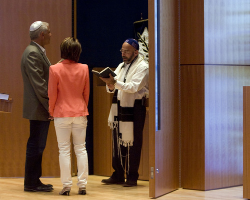 Kim Raff  |  The Salt Lake Tribune (middle) Rabbi Joshua Aaronson blesses the upcoming marriage of (left) Lee Gerstin and (middle) Shari Levatin during a Shabbat service at Temple Har Shalom in Park City on May 31, 2013. Rabbi Aaronson will be leaving the congregation at the end of the month.
