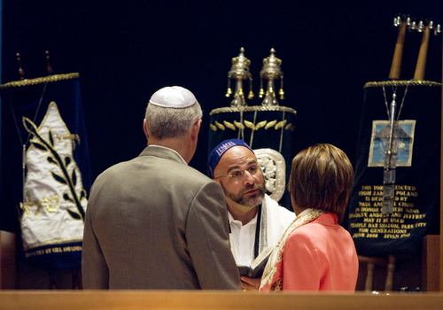 Kim Raff  |  The Salt Lake Tribune (middle) Rabbi Joshua Aaronson blesses the upcoming marriage of (left) Lee Gerstin and (right) Shari Levatin during a Shabbat service at Temple Har Shalom in Park City on May 31, 2013. Rabbi Aaronson will be leaving the congregation at the end of the month.