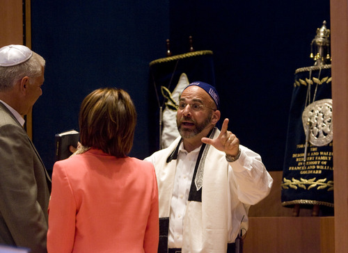 Kim Raff  |  The Salt Lake Tribune Rabbi Joshua Aaronson blesses the upcoming marriage of (left) Lee Gerstin and (middle) Shari Levatin during a Shabbat service at Temple Har Shalom in Park City on May 31, 2013. Rabbi Aaronson will be leaving the congregation at the end of the month.