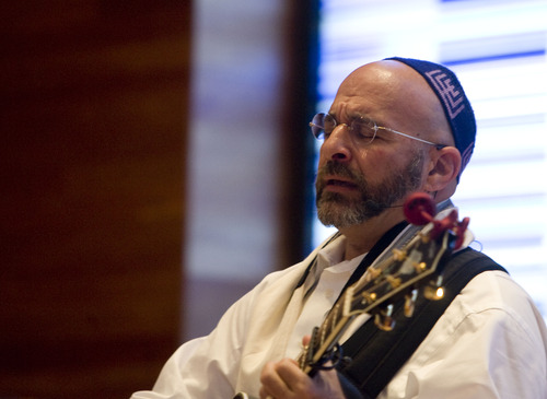 Kim Raff  |  The Salt Lake Tribune Rabbi Joshua Aaronson leads the congregation in a song during Shabbat service at Temple Har Shalom in Park City on May 31, 2013. Rabbi Aaronson will be leaving the congregation at the end of the month.