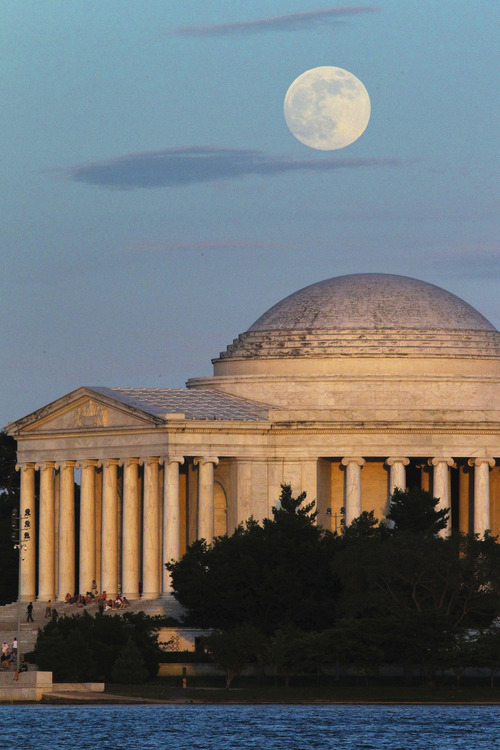 "A full moon rises behind the Jefferson Memorial in Washington Saturday, June 22, 2013. The larger than normal moon called the ""Supermoon"" happens only once this year as the moon on its elliptical orbit is at its closest point to earth. (AP Photo/J. David Ake)"