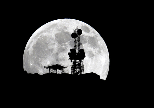 Keith Johnson | The Salt Lake Tribune  The Supermoon rises over a radio tower on the mountain ridge east of Salem, Utah June 22, 2013.