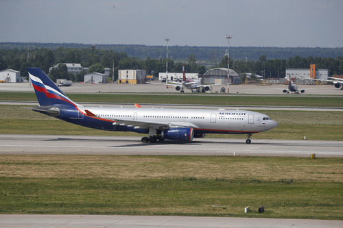 The Aeroflot Airbus A330 plane that was to carry National Security Agency leaker Edward Snowden on a flight to Havana, Cuba, taxies out at Sheremetyevo airport, Moscow, Monday, June 24, 2013. Snowden, who arrived in Moscow on Sunday from Hong Kong, booked a seat for the flight to Cuba, but he was not seen on the plane. (AP Photo/ Sergei Ivanov)