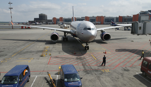 The Aeroflot Airbus A330 plane that is to carry National Security Agency leaker Edward Snowden on a flight to Havana, Cuba, arrives at the gate at Sheremetyevo airport, Moscow,  Monday, June 24, 2013. Snowden arrived in Moscow on Sunday from Hong Kong, where he had been hiding for several weeks. Ecuador's foreign minister said Sunday that the country is considering his application for asylum. (AP Photo/Alexander Zemlianichenko)