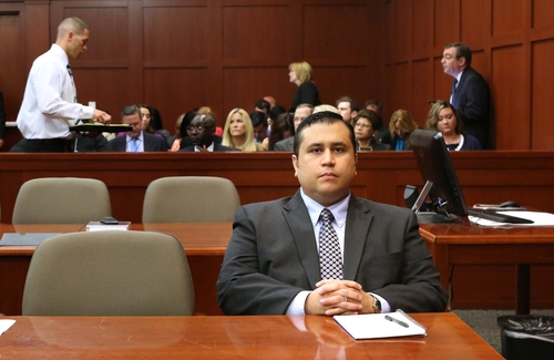 George Zimmerman waits for his defense counsel to arrive in Seminole circuit court for his trial, in Sanford, Fla., Monday, June 24, 2013. Zimmerman has been charged with second-degree murder for the 2012 shooting death of Trayvon Martin. (AP Photo/Orlando Sentinel, Joe Burbank/Pool)