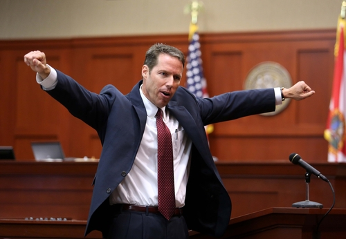 Assistant State Attorney John Guy gestures during his opening statement in George Zimmerman's trial in Seminole circuit court, in Sanford, Fla., Monday, June 24, 2013.  Zimmerman has been charged with second-degree murder for the 2012 shooting death of Trayvon Martin. (AP Photo/Orlando Sentinel, Joe Burbank, Pool)