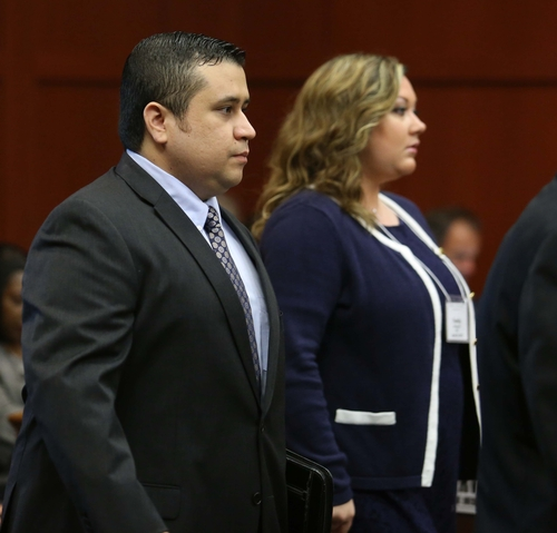 George Zimmerman, left, arrives in Seminole circuit court, with his wife Shellie, in Sanford, Fla., Monday, June 24, 2013. Zimmerman is accused in the fatal shooting of Trayvon Martin. Zimmerman has been charged with second-degree murder for the 2012 shooting death of Trayvon Martin. (AP Photo/Orlando Sentinel, Joe Burbank/Pool)