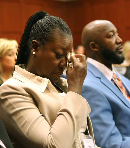 Trayvon Martin's mother, Sybrina Fulton, left, cries as she listens to the description of her son's death during opening statements in the George Zimmerman trial, with Trayvon's father, Tracy Martin, right, in Seminole circuit court, in Sanford, Fla., Monday, June 24, 2013. Zimmerman has been charged with second-degree murder for the 2012 shooting death of Trayvon Martin. (AP Photo/Orlando Sentinel, Joe Burbank, Pool)