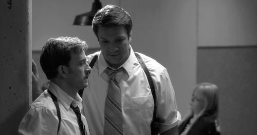 """Nathan Fillion (center) plays Dogberry, the comic-relief constable in Joss Whedon's modern-dress adaptation of Shakespeare's """"Much Ado About Nothing."""" The movie also stars Tom Lenk (left) and Riki Lindhome (background). Elsa Guillet-Chapuis     Roadside Attractions"""