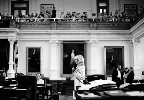 Sen. Wendy Davis, D-Fort Worth, cener, filibusters in an effort to kill an abortion bill, Tuesday, June 25, 2013, in Austin, Texas. The bill would ban abortion after 20 weeks of pregnancy and force many clinics that perform the procedure to upgrade their facilities and be classified as ambulatory surgical centers.  (AP Photo/Eric Gay)