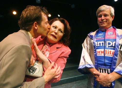 Actor Kevin Doyle, right,  as Salt Lake City Mayor Rocky Anderson looks on as Alexis Baigue as Borat kisses Arika Schockmel as Enid Greene in Salt Lake Acting Company's 2007 Saturday's Voyeur.  This year's Voyeur will have a Rocky Anderson theme as well as Utah based character humor.  photo by Danny Chan La/The Salt Lake Tribune 5-29-2007