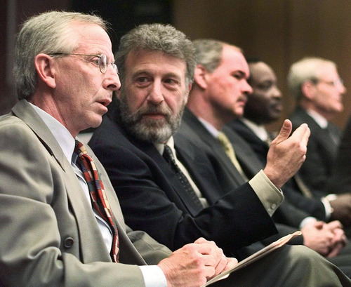 "Ben Margot  |  Associated Press file photo FILE - In this Thursday, May 6, 1999 file photo, George Zimmer, second from left, gestures to Andy Dolich prior to a meeting, in Oakland, Calif. On Tuesday, June 25, 2013, Men's Wearhouse Inc., offered some details on why it parted ways with founder Zimmer, saying that Zimmer seemed to have difficulty ""accepting the fact that Men's Wearhouse is a public company with an independent board of directors and that he has not been the chief executive officer for two years."""