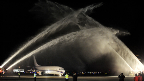 A plane carrying the Stanley Cup winning Chicago Blackhawks hockey team is welcomed with water cannons after arriving at O'Hare International Airport in Chicago, on Tuesday, June 25, 2013. (AP Photo/Paul Beaty)