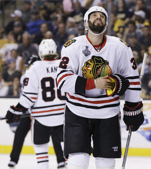 Chicago Blackhawks defenseman Michal Rozsival (32), of the Czech Republic, looks to the scoreboard during the second period in Game 6 of the NHL hockey Stanley Cup Finals against the Boston Bruins, Monday, June 24, 2013 in Boston. (AP Photo/Elise Amendola)
