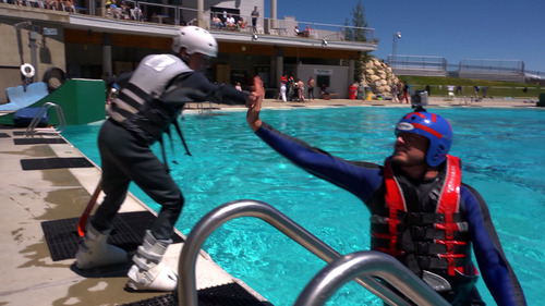"Courtesy KUED | Salt Lake Tribune writer Brett Prettyman gives a high-five to his son, William, as they take part in ""Tramp to Ramp"" freestyle ski lessons at Utah Olympic Park in June 2012. The aerial ski lessons and bobsled rides are part of The Utah Bucket List show airing on KUED-Channel 7 in August."