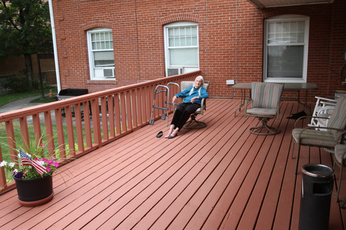 Rick Egan  | The Salt Lake Tribune   Colleen Evans relaxes on the deck, at the Sara Daft Home, an assisted living center on 1300 East in Salt Lake City, Monday, June 24, 2013. This year marks the100th anniversary of the Sara Daft Home.