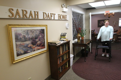 Rick Egan  | The Salt Lake Tribune   Peggy Godfrey walks down the hall of the Sara Daft Home, an assisted living center on 1300 East in Salt Lake City, Monday, June 24, 2013. This year marks the100th anniversary of the Sara Daft Home.