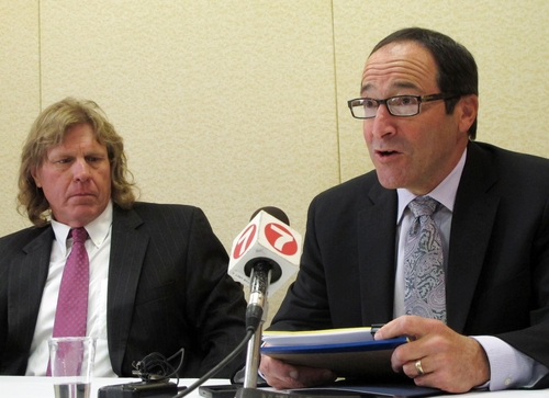 Boise attorneys Timothy Walton, left, and Andrew Chasan share details of a new federal lawsuit filed Monday, June 24, 2013, in Boise, Idaho.  Walton and Chasan represent four anonymous former Boy Scouts who claim they were sexually abused. The defendants in the case include the Boy Scouts of America and The Church of Jesus Christ of Latter-day Saints. (AP Photo/Todd Dvorak)