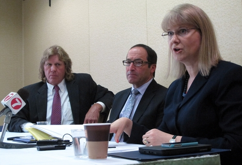 Boise attorneys Timothy Walton, left, and Andrew Chasan, middle, join Portland attorney Gilion Dumas in discussing details of a new federal lawsuit filed Monday, June 24, 2013, in Boise, Idaho. The legal team filed the case on behalf of four anonymous former Boy Scouts who claim they were sexually abused. The defendants in the case include the Boy Scouts of America and The Church of Jesus Christ of Latter-day Saints. (AP Photo/Todd Dvorak)