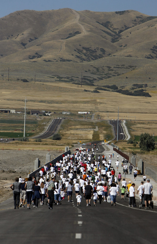 Francisco Kjolseth  |  The Salt Lake Tribune UDOT introduced the initial stretch of the Mountain View corridor in September with a fun run for charity on the road before opening to cars.