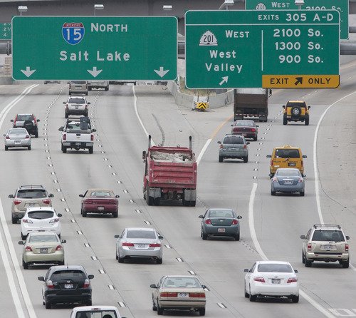 Steve Griffin | The Salt Lake Tribune   Rush hour traffic builds on I-15 near the I-80 interchange in Salt Lake City, Utah Monday June 24, 2013. Salt Lake Chamber and its Utah Transportation Coalition will release a study on the impact of investing in Utah's transportation system.