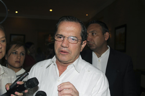 Ecuador's Foreign Mister Ricardo Patino speaks to reporters at a hotel in Hanoi, Vietnam, on Tuesday, June 25, 2013. Asked for information about the whereabouts of Edward Snowden, the former National Security Agency contractor wanted for revealing classified secrets, Patino said he doesn't know where Snowden is or what travel documents he may be using. (AP Photo/Tran Van Minh)
