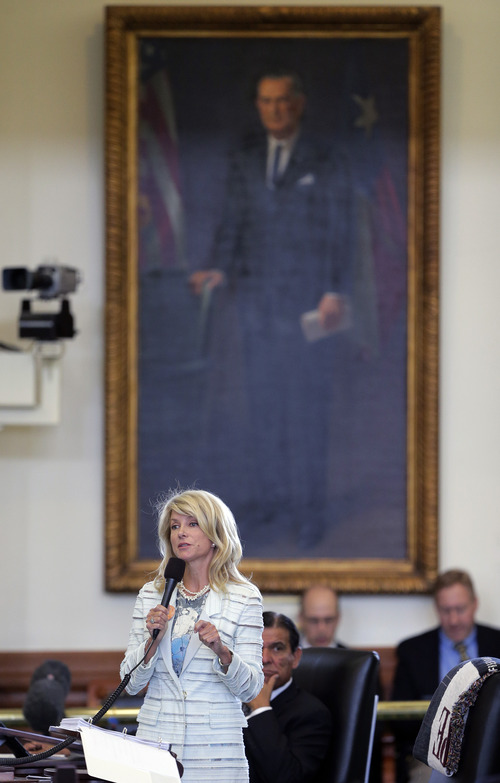 Standing in front of a portrait of President Lyndon B. Johnson, Sen. Wendy Davis, D-Fort Worth, begins a filibuster in an effort to kill an abortion bill, Tuesday, June 25, 2013, in Austin, Texas. The bill would ban abortion after 20 weeks of pregnancy and force many clinics that perform the procedure to upgrade their facilities and be classified as ambulatory surgical centers.  (AP Photo/Eric Gay)
