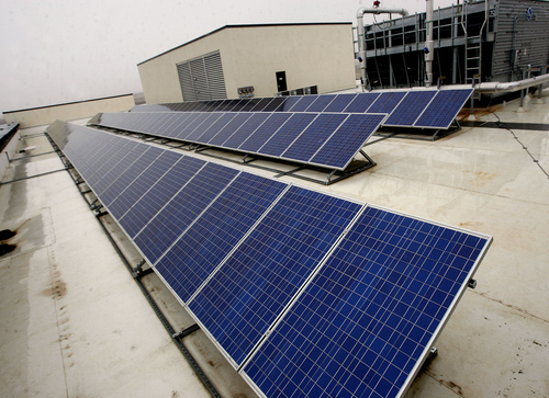 Tribune file photo Kennecott Land's Daybreak Corporate Center has achieved a platinum rating in the U.S. Green Building Council's LEED program -- the first building in Utah to do so. The building has special energy-saving features including a solar power network fed by these panels on the roof.