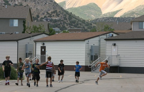 Leah Hogsten  |  The Salt Lake Tribune Butterfield Canyon Elementary students head back to their classrooms after recess. The school is overflowing with its 1,300 students, judging from the more than a dozen portable classrooms placed around the school property. Jordan School District officials are floating a tax hike to raise cash for new school buildings.