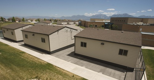 Leah Hogsten  |  The Salt Lake Tribune Butterfield Canyon Elementary School is overflowing with its 1,300 students, judging from the more than a dozen portable classrooms placed around the school property. Jordan School District officials are floating a tax hike to raise cash for new school buildings.
