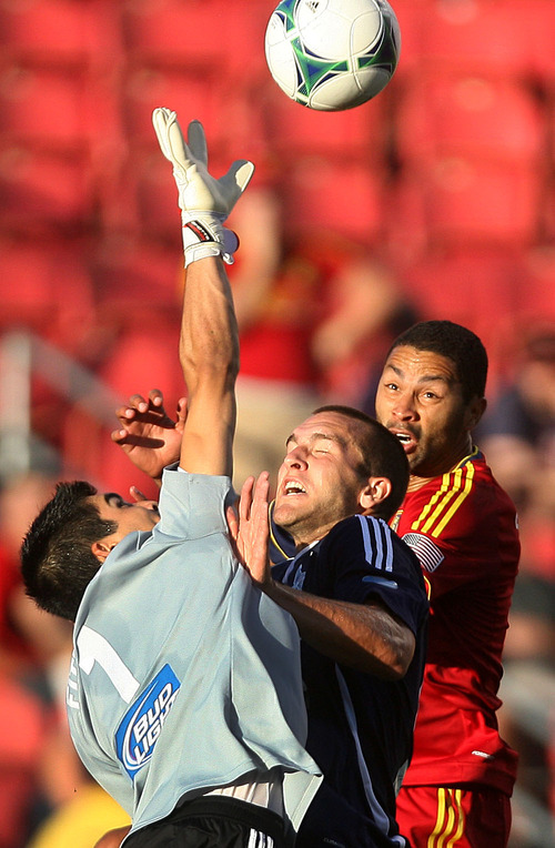 Steve Griffin | The Salt Lake Tribune   Carolina goal keeper Akira Fitzgerald stretches for the ball as he knocks it away from RSL's Álvaro Saborío, right, who is being marked by Carolina's Austen King during the RSL versus Carolina Railhawks game in the U.S. Open Cup at Rio TInto Stadium in Sandy, Utah Wednesday June 26, 2013.