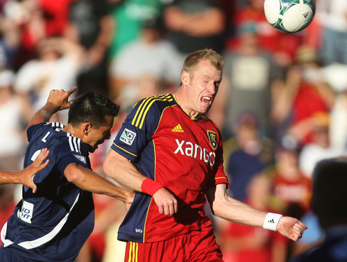 Steve Griffin | The Salt Lake Tribune   RSL's Nat Borcers heads the ball away from Carolina's Kupono Low during the RSL versus Carolina Railhawks game in the U.S. Open Cup at Rio TInto Stadium in Sandy, Utah Wednesday June 26, 2013.