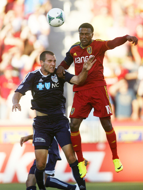 Steve Griffin | The Salt Lake Tribune   RSL's Robbie Findley heads the ball away from Carolina's Austen King during the RSL versus Carolina Railhawks game in the U.S. Open Cup at Rio TInto Stadium in Sandy, Utah Wednesday June 26, 2013.