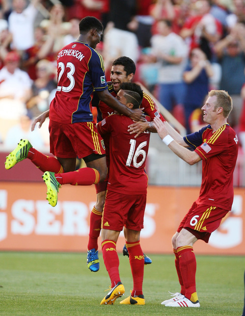Steve Griffin | The Salt Lake Tribune   RSL players jump on teammate Tony Beltran after he scored the first goal of the game against the Carolina Railhawks in the U.S. Open Cup at Rio TInto Stadium in Sandy, Utah Wednesday June 26, 2013.