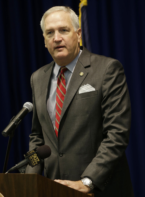 Alabama Attorney General Luther Strange talks with reporters in Montgomery, Ala., Tuesday, June 25, 2013. Strange applauded a ruling by a deeply divided Supreme Court on Tuesday that halted enforcement of the federal government's most potent tool to stop voting discrimination over the past half century, saying it does not reflect racial progress.   (AP Photo/Dave Martin)