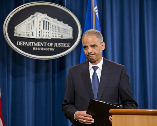 Attorney General Eric Holder leaves after speaking where he expressed disappointment in the Supreme Court's 5-4 ruling in the Alabama voting rights case, Shelby County v. Holder, Tuesday, June 25, 2013, at the Justice Department in Washington. The court declared unconstitutional a provision of the landmark Voting Rights Act that determines which states and localities must get Washington's approval for proposed election changes. (AP Photo/J. Scott Applewhite)