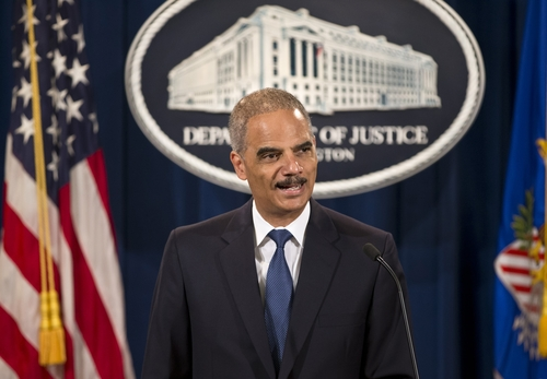 Attorney General Eric Holder expresses disappointment in the Supreme Court's 5-4 ruling in the Alabama voting rights case, Shelby County v. Holder, Tuesday, June 25, 2013, at the Justice Department in Washington. The court declared unconstitutional a provision of the landmark Voting Rights Act that determines which states and localities must get Washington's approval for proposed election changes. (AP Photo/J. Scott Applewhite)
