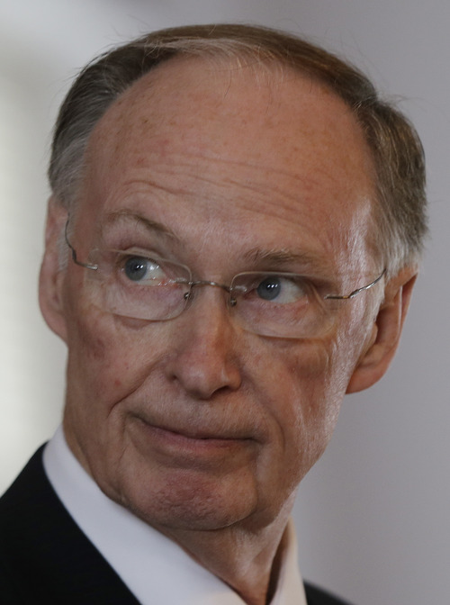 Alabama Gov. Robert Bentley talks with reporters in Montgomery, Ala., Tuesday, June 25, 2013. Bentley applauded a ruling by a deeply divided Supreme Court on Tuesday that halted enforcement of the federal government's most potent tool to stop voting discrimination over the past half century, saying it does not reflect racial progress. (AP Photo/Dave Martin)