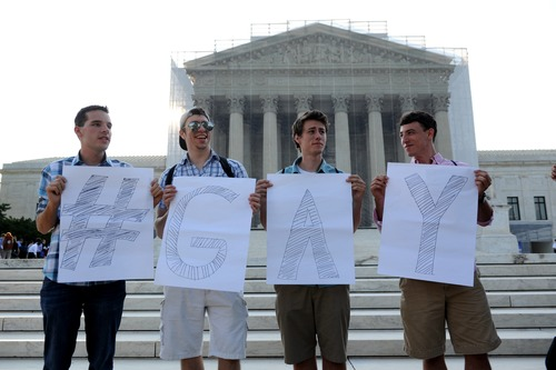 Casey Oakes, 26, of Monroe, N.J., left, Dan Choyce, 21, of Sicklerville, N.J., center left, Zach Wulderk, 19, of Hammonton, N.J., and his brother Dylan Wulderk, 22, right, wait for a ruling on same sex marriage at the Supreme Court in Washington, Wednesday, June 26, 2013. (AP Photo/Cliff Owen)