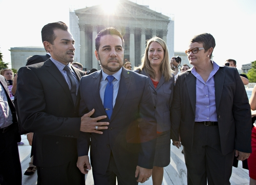 Arriving at the Supreme Court in Washington, Wednesday, June 26, 2013, on a final day for decisions in two gay marriage cases are plaintiffs in the California Proposition 8 case, from left, Paul Katami, his partner Jeff Zarrillo, and Sandy Stier and her partner Kris Perry. (AP Photo/J. Scott Applewhite)