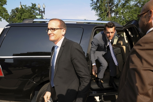Chad Griffin, president of the Human Rights Campaign, left, and Adam Umhoefer, executive director of the American Foundation for Equal Rights arrive at the Supreme Court in Washington, Wednesday, June 26, 2013. (AP Photo/Cliff Owen)